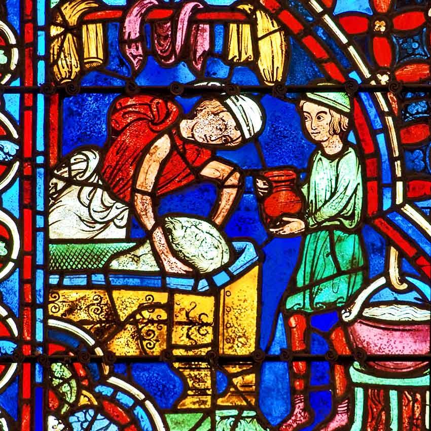 Витраж в Шартрском соборе. Жертвователи: пекари замешивают тесто.
