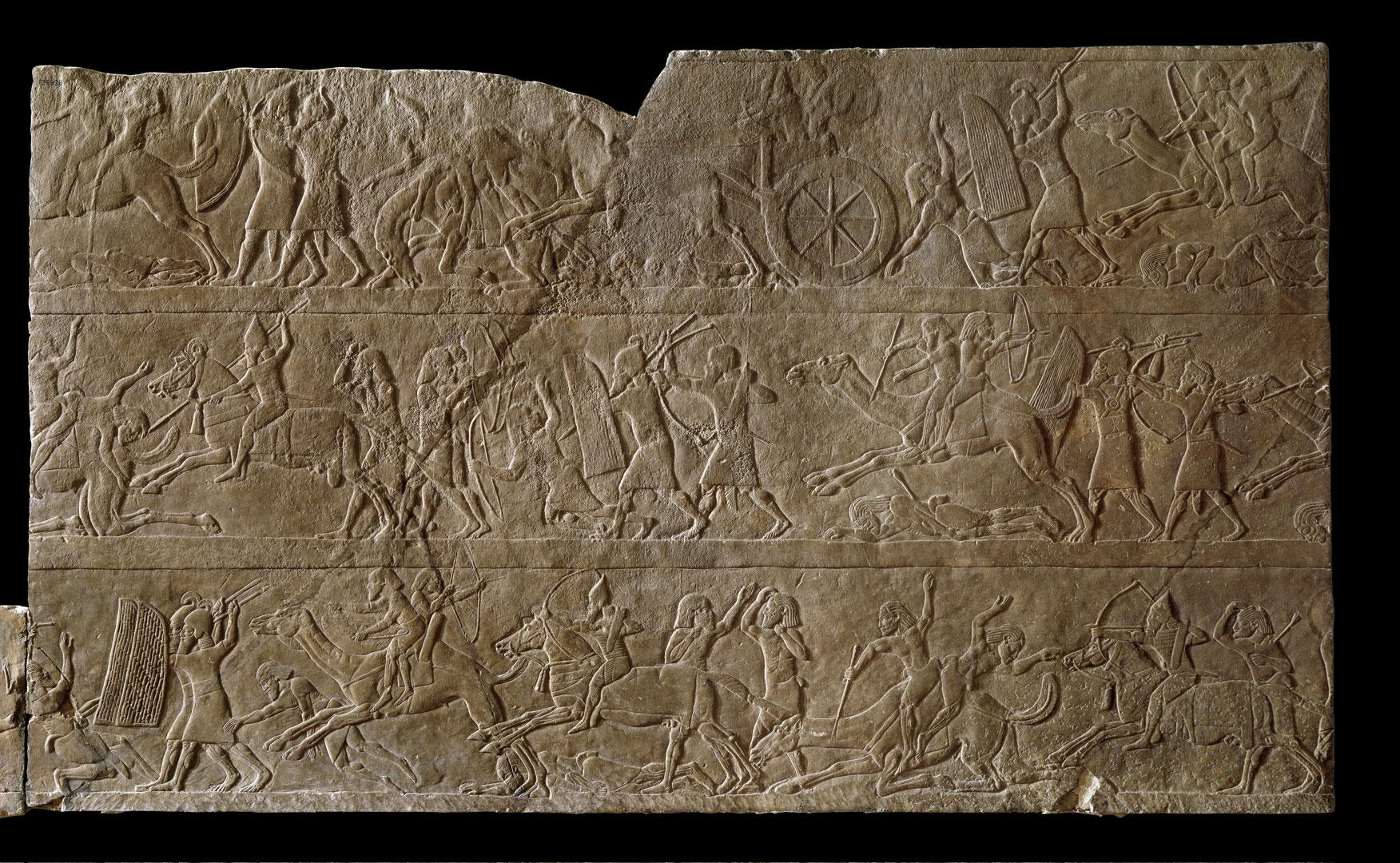 Настенный рельеф с изображением ассирийских солдат, преследующих арабское войско на верблюдах